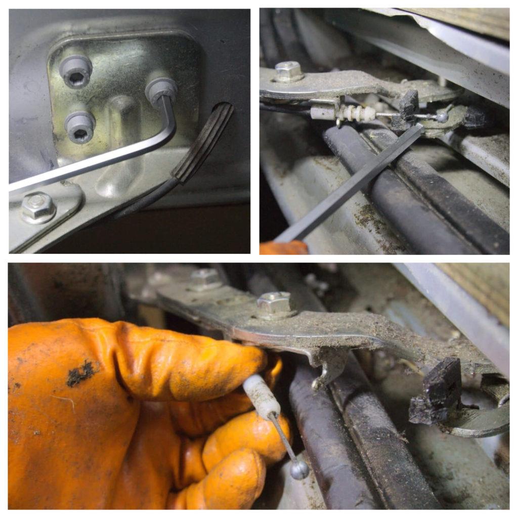 Detailaufnahme der Hand eines Mechanikers, wie er das untere Scharnier an der Schiebetür des Ducatos mit einem 6er Imbus löst und den Bautenzug mit der Hand aus der Führung löst.