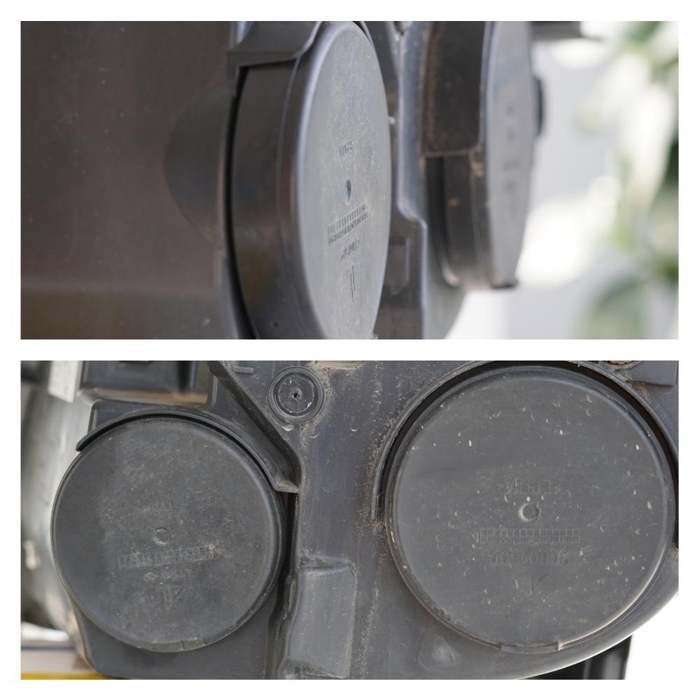Die beiden Gummikappen auf der Rückseite des ausgebauten Scheinwerfers, hinter denen sich die Leuchtmittel befinden.